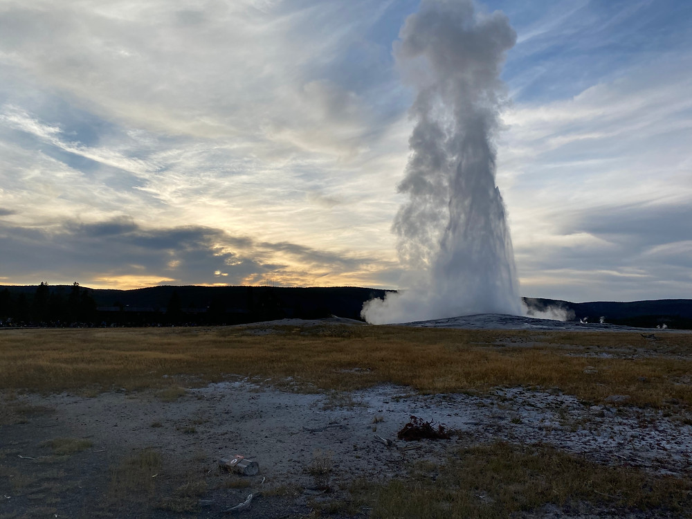 With a backdrop of a beautiful sunset, Old Faithful in Yellowstone National Park erupts majestically - but for how much longer before climate change takes its toll?