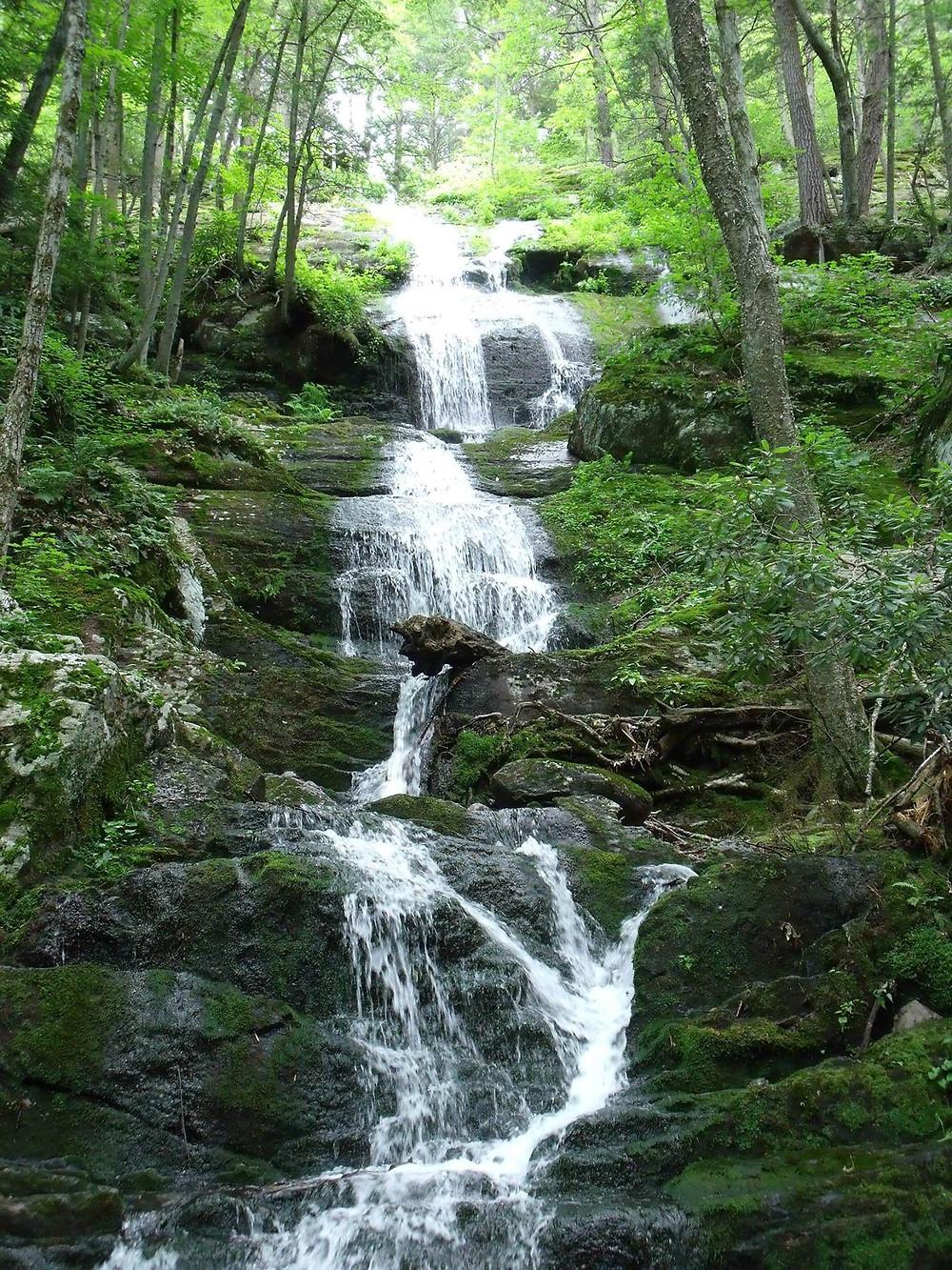 Multiple waterfalls cascade down the hillside - Buttermilk Falls in New Jersey