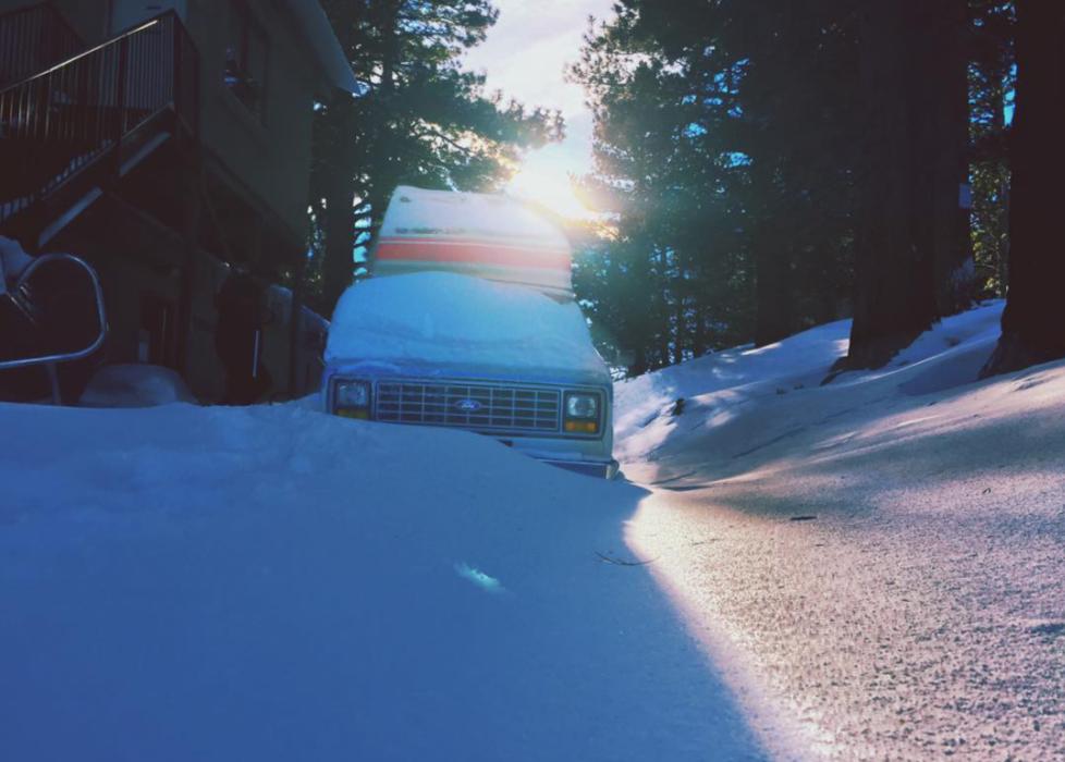 Spirit of the west camper van, snowed in at a ski lodge in Lake Tahoe
