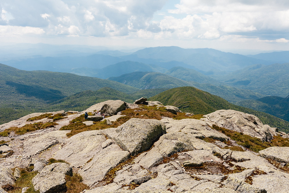 The rocky summit of Mount Marcy in upstate New York provides an incredible view of the surrounding Adirondack Mountain range