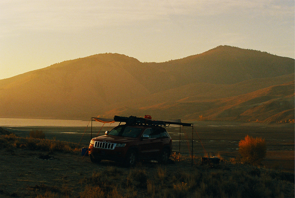A 2011 Jeep Grand Cherokee set up for boondocking, camping by the Lost River Range in Mackay, ID