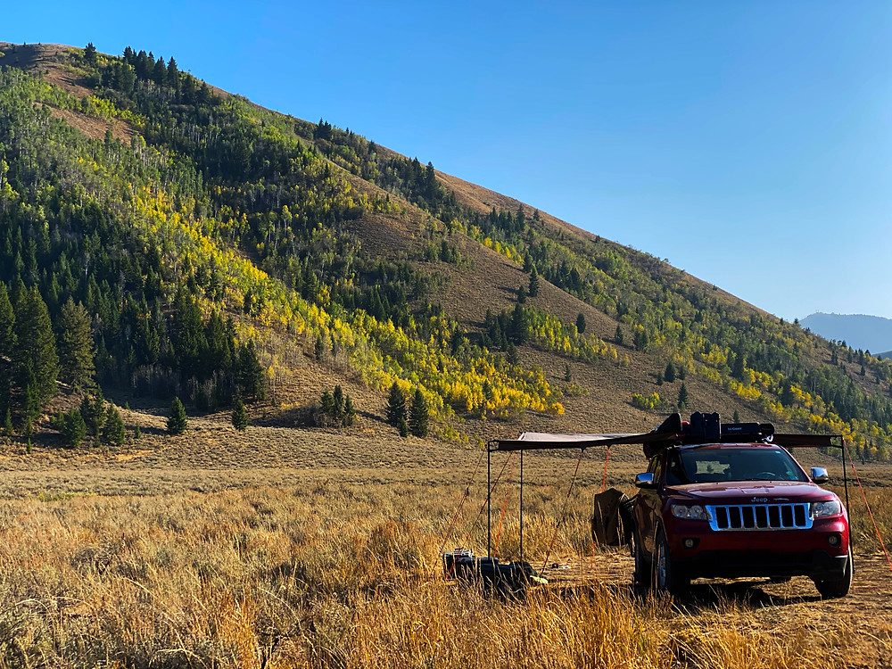 A 2011 Jeep Grand Cherokee set up for boondocking, camping by the Pioneer Mountains in Sun Valley, ID