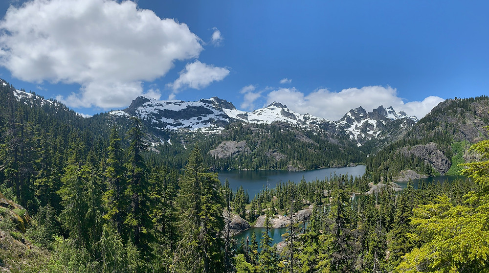 Spectacle Lake is nestled in the heart of the Cascades, surrounded by incredibly green pine trees and snow-covered mountains