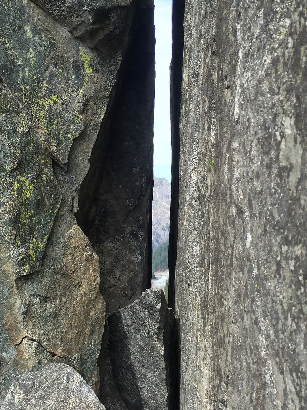 Damnation Chimney at Jello Tower in Leavenworth, Washington is impossibly tall, incredibly narrow, a clearing sandwiched between two enormous grey hunks of rock. Leavenworth, Washington