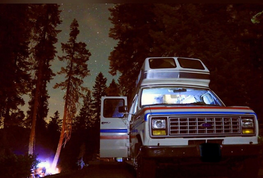 The Spirit Of The West van parked at night, nestled among the trees of Sequoia National Park