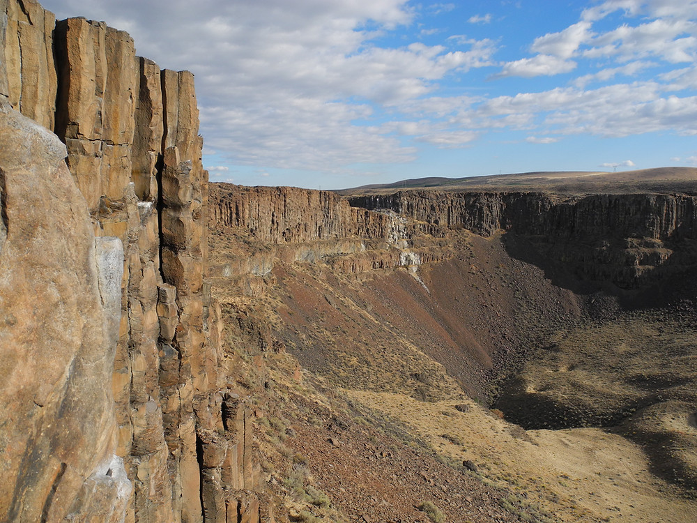 brown columnar basalt stretches for miles in a natural quarry at Frenchman Coulee in Vantage, Washington