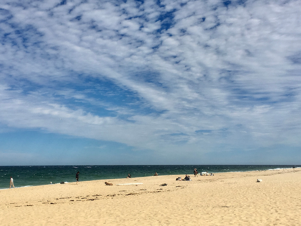 Wispy clouds scattered across the sky above Race Point Beach in Provincetown, Massachusetts