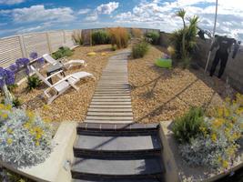 Direct access to beach through garden gate.