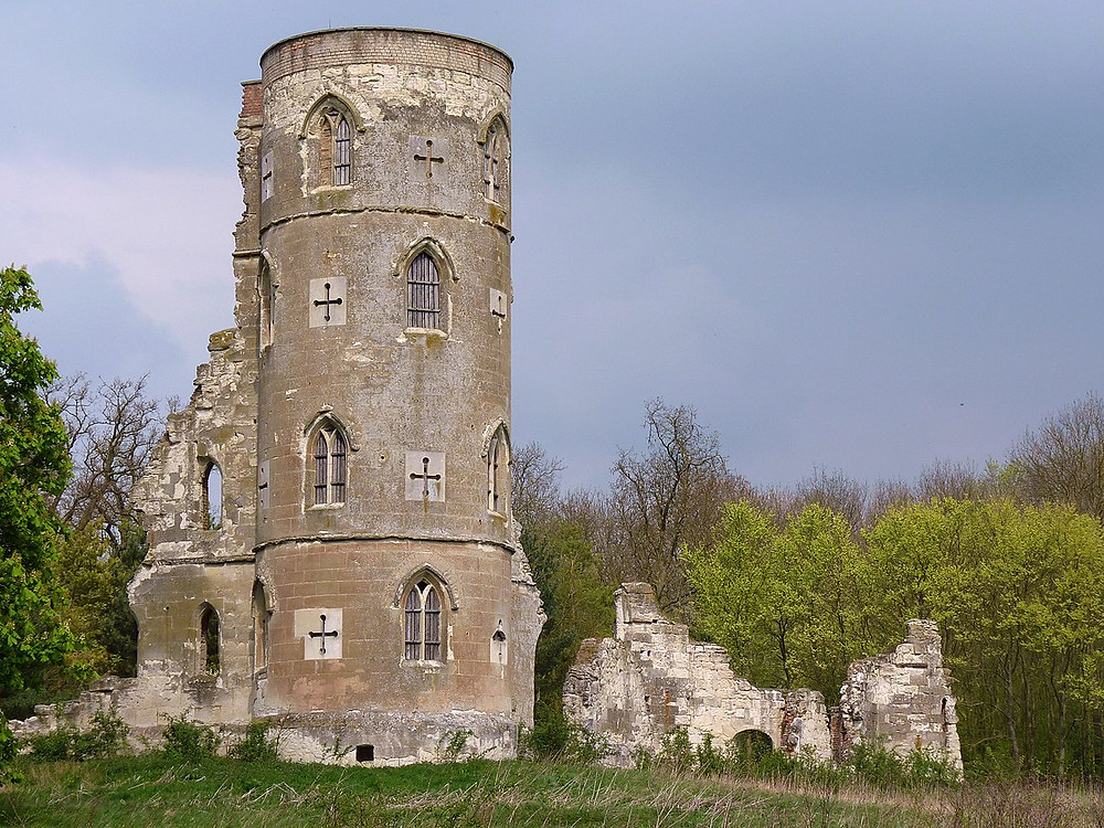 A crumbling tower with several little windows