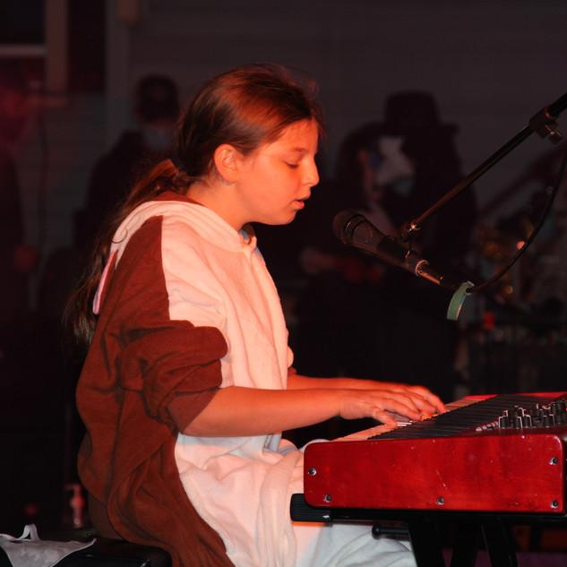 "Addie performing ""A Million Dreams"""