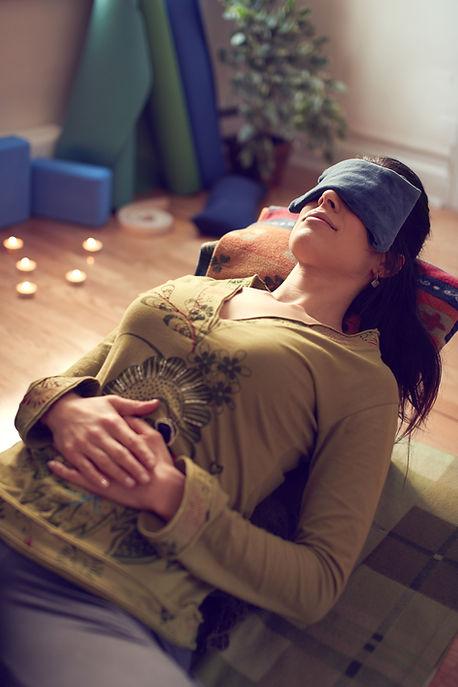 Attractive mixed race woman doing restorative yoga.jpg