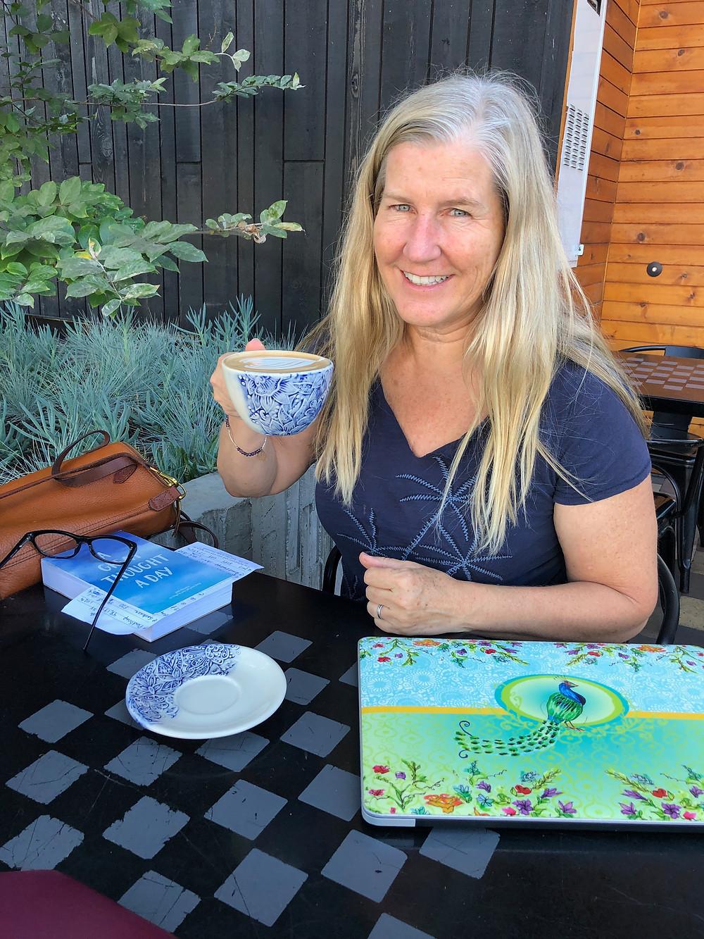 Siri Kay Jostad of Wander Away with Siri Kay sipping coffee at James Coffee in Bankers Hill San Diego California
