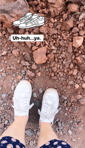 White tennis shoes for a lava rock hike warn by Siri Kay Jostad of Wander Away with Siri Kay