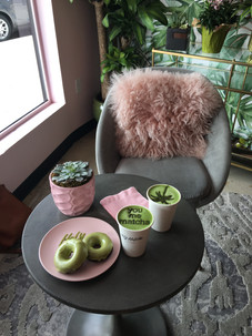 window seat at Holy Match San Diego California with a lambskin tossed over a chair and table filled with hot matcha latte drinks