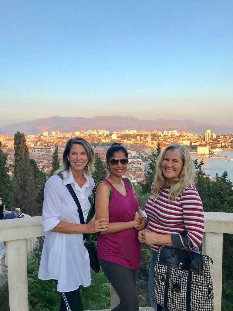 Siri Kay Jostad of Wander Away with Siri Kay in Split with Katie Bowles and Vaishali Patel of Sanskar Teaching overlooking the city of Split Croatia from the Marjan Forest Park/Marjan Hill hike