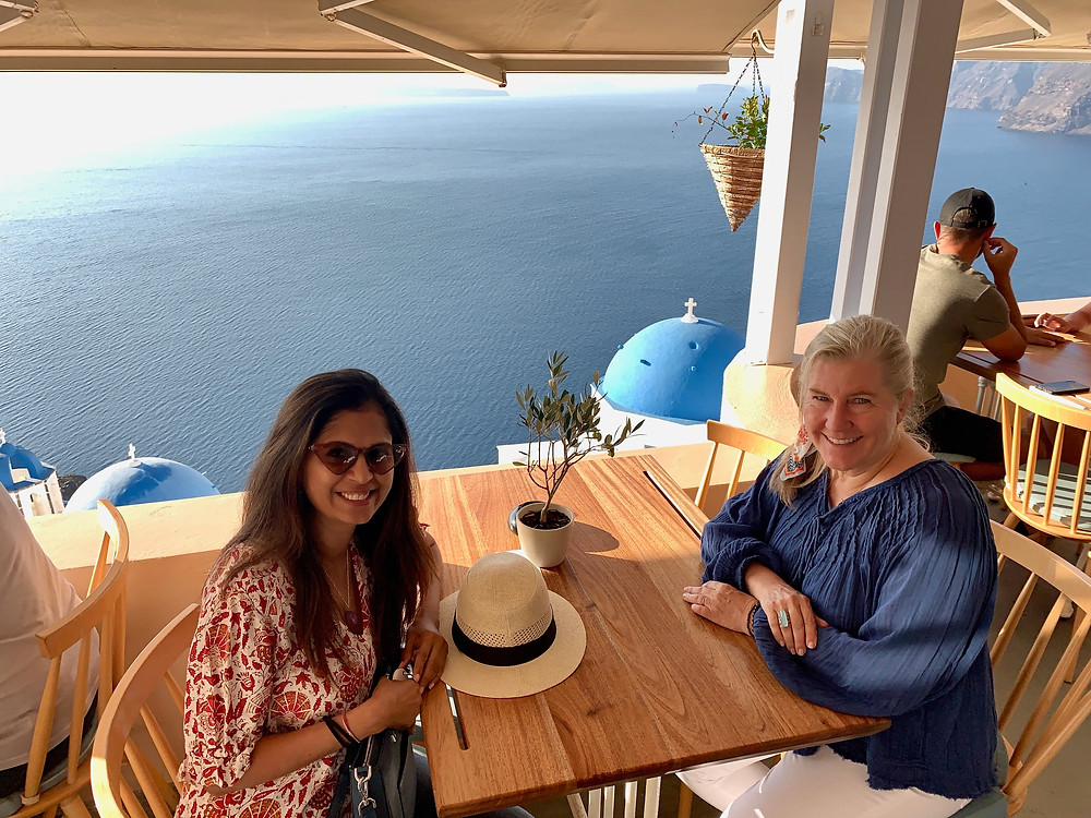 Vaishali Patel of Sanskar Teaching and Siri Kay Jostad of Wander Away with Siri Kay dining at Terpsi N Oia in Santorini Greece