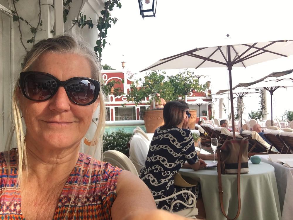 Siri Kay Jostad of Wander Away with Siri Kay on the poolside terrace at Le Sirenuse hotel in Positano, Italy