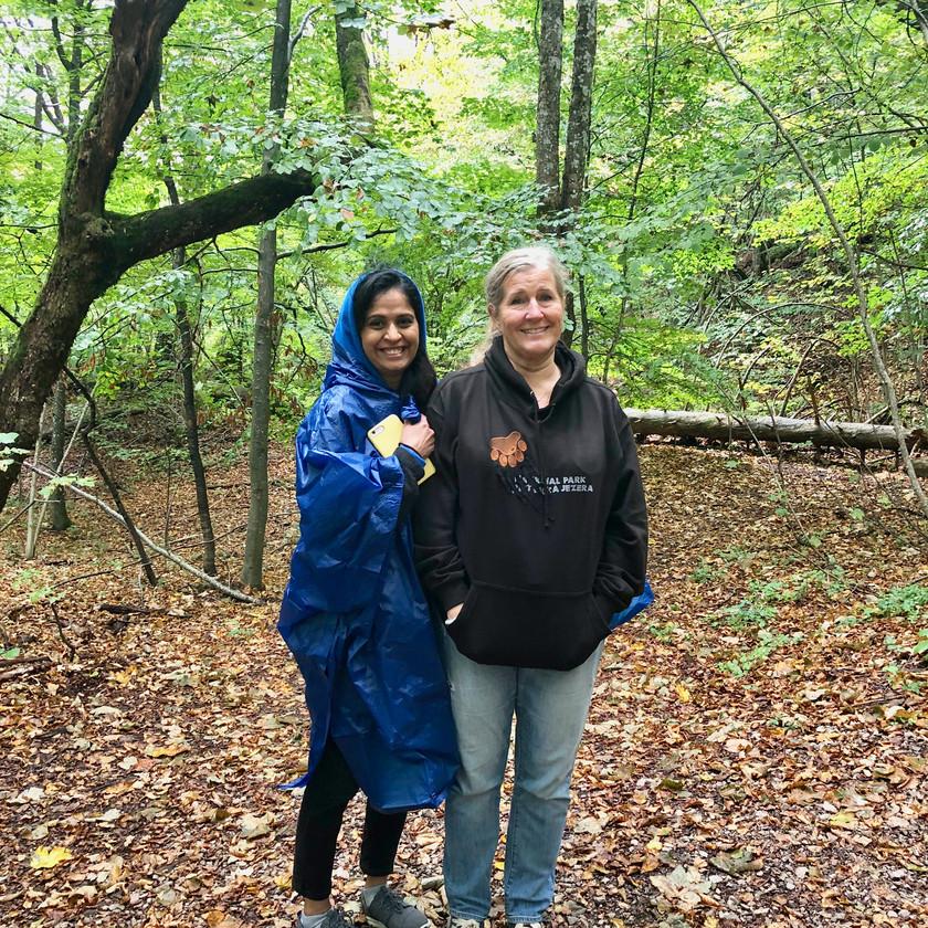 Vaishali Patel and Siri Kay Jostad wet from rain in Plitvice Lakes National Park, Croatia