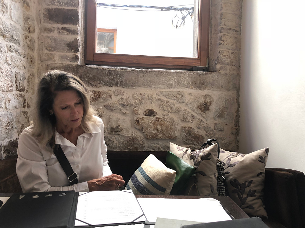 Katie Bowles looking at the menu for Restoran Apetit in Split Croati