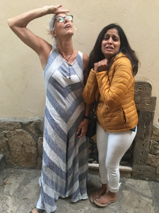 Katie Bowles and Vaishali Patel from Sanskar Teaching one feigning hot and the other cold in Positano Italy