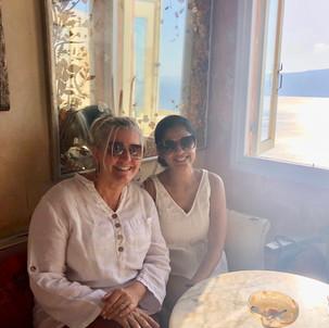 Siri Kay Jostad of Wander Away with Siri Kay and Vaishali Patel of Sanskar Teaching enjoying breakfast at Meteor Cafe in Oia Santorini Greece
