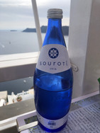 Souroti Blue glass water bottle at Pelekanos Restaurant in Oia Santorini Greece