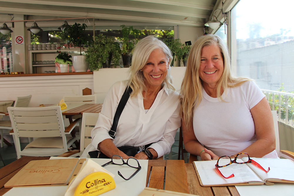 Siri Jostad of Wander Away with Siri Kay sitting with Katie Bowles at Collina Bakery in Positano Italy