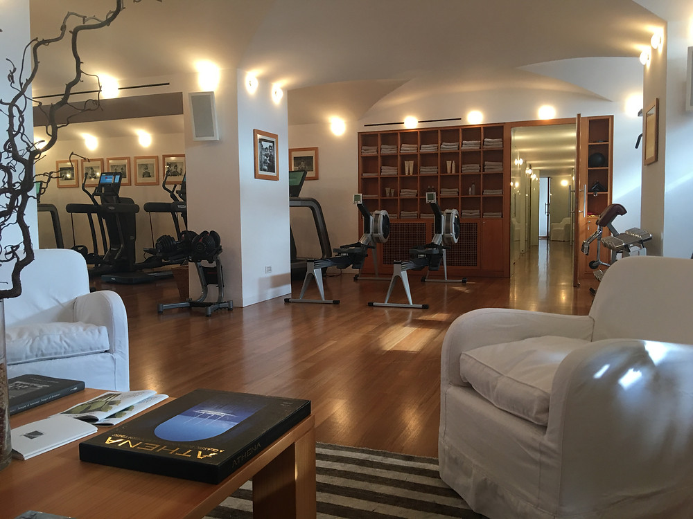 Inside the Le Sirenuse Spa in Positano Italy, this is the 'work out' room with a few weights and cardio machines.  It is open and adjacent to the waiting area for spa treatments