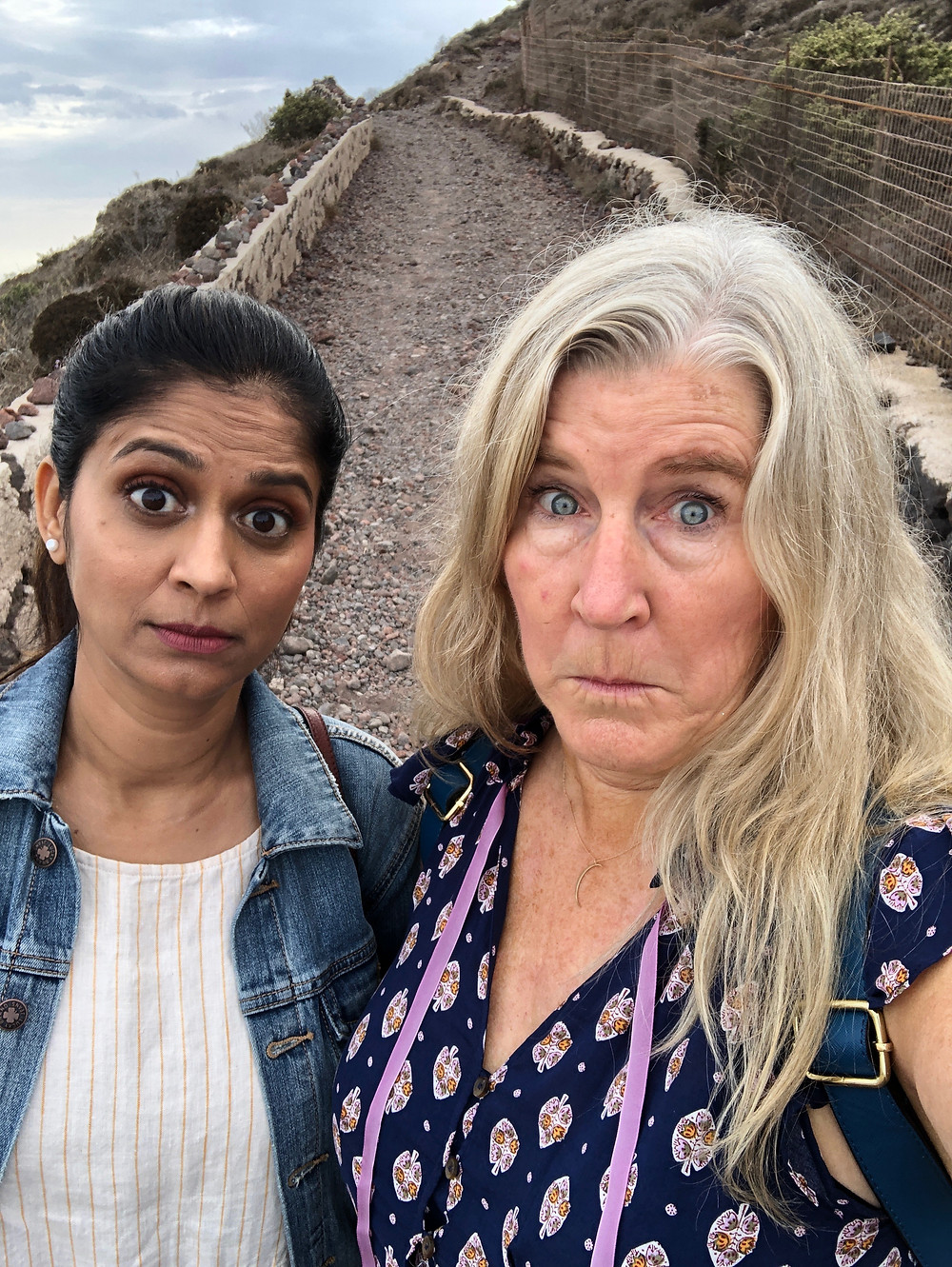 Vaishali Patel of Sanskar Teaching and Siri Kay Jostad of Wander Away with Siri Kay on the path between Oia and Fira in Santorini Greece