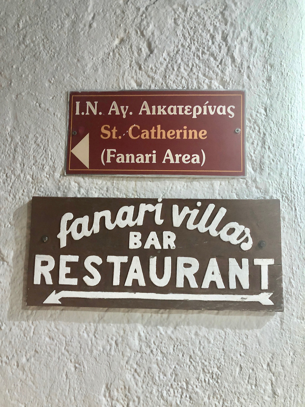 direction signs to Fenari Villas and Restaurant in Oia Santorini Greece