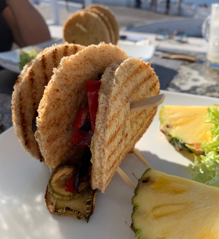 Vegetable breakfast sandwich at Entrance to Passaggio Bites and drinks in Oia Santorini Greece