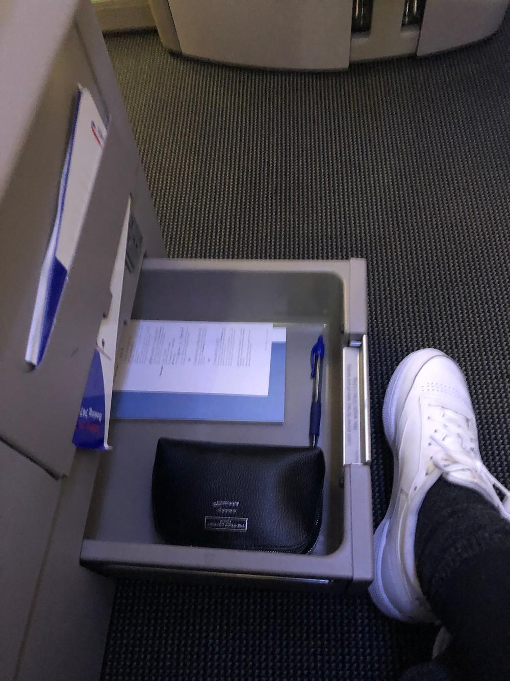 Lower drawer on Club World British Airways seat.  Has The White Company amenity kit