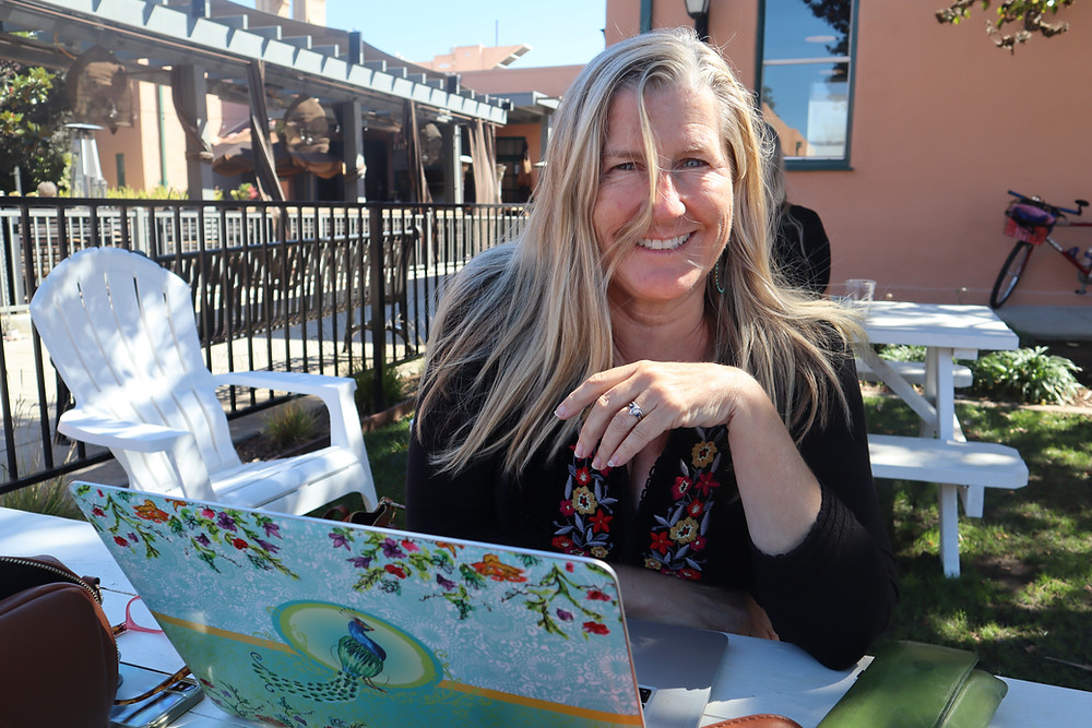 Siri Kay Jostad of Wander Away with Siri Kay sitting outside at Moniker General in Liberty Station San Diego California
