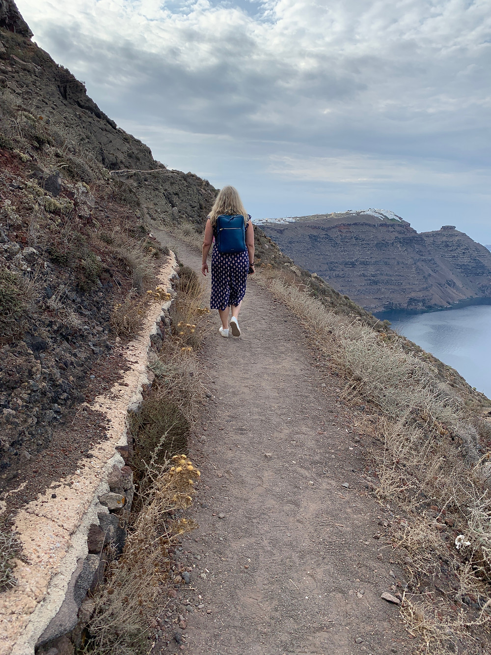 Siri Kay Jostad of Wander Away with Siri Kay hiking the path between Oia and Fira in Santorini Greece