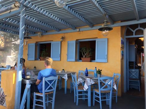 Colorful outdoor patio for Roka Restaurant in Oia Santorini Greece