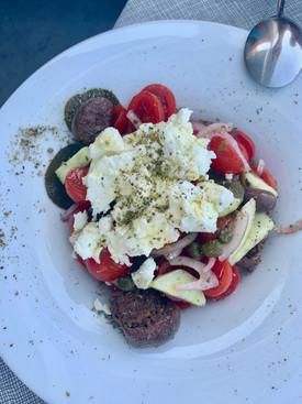 Santorini salad with carob rusks cheese and tomatoes at Roka Restaurant in Oia Santorini Greece