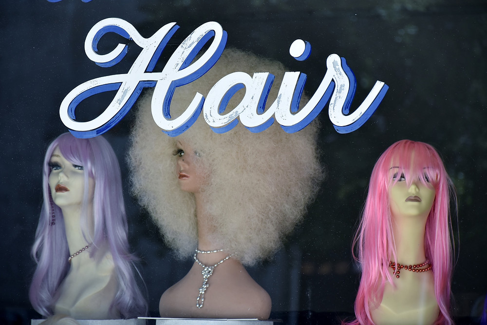 Image of three wigs on mannequin heads