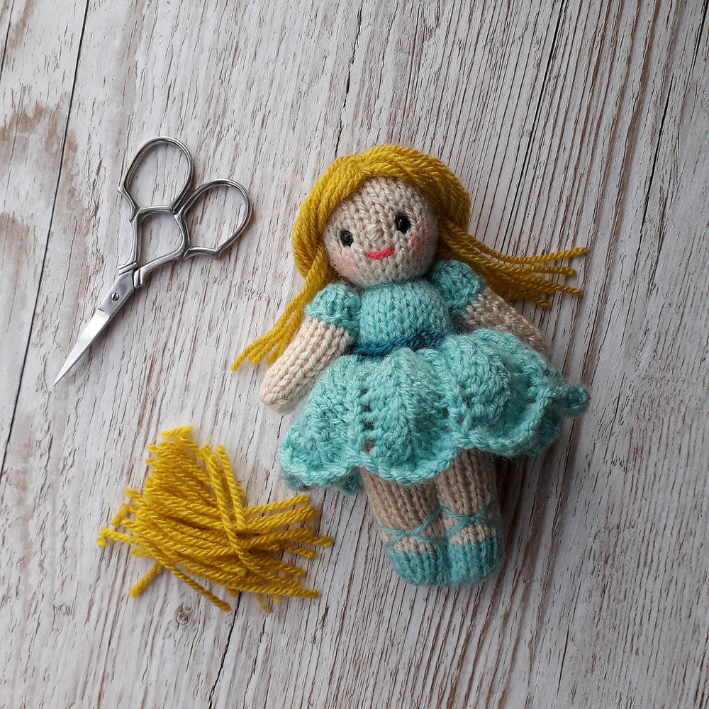 small knitted doll