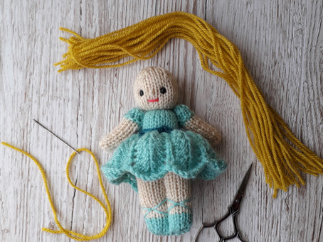How I add yarn hair to my small knitted dolls