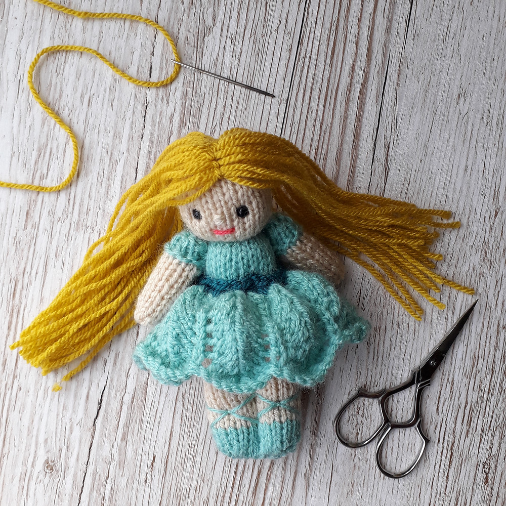 how to add hair to a knitted doll
