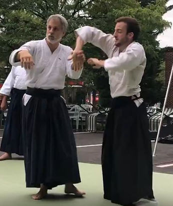father and son doing aikido