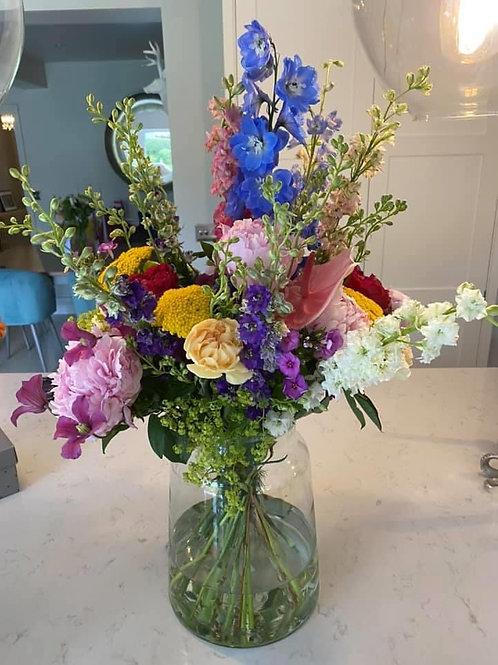 Long stem vase arrangement