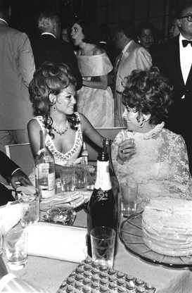 Claudia Cardinale and Liz Taylor at a party in Venice during Venice Film Festival, 1962