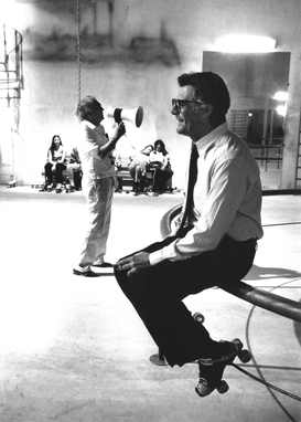 Marcello Mastroianni during a break on the set of City of Women in the background Federico Fellini, 1979