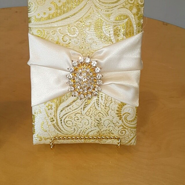 Oh the beauty! Take a look at this beautiful padded fabric box invitation we created and constructed