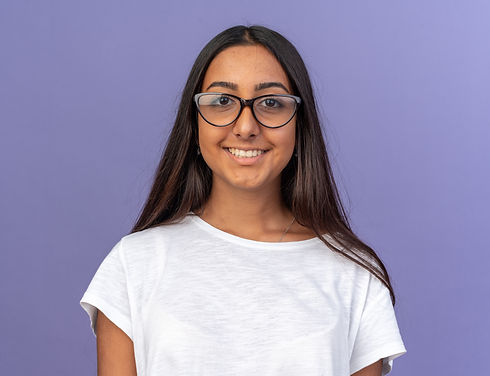 young-girl-white-t-shirt-wearing-glasses-looking-camera-with-smile-happy-face-standing-blu