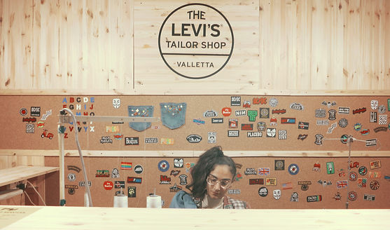 One of our staff, at the Levi's Tailor Shop, in Valletta.