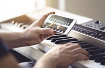 Piano lesson online. Man watching video
