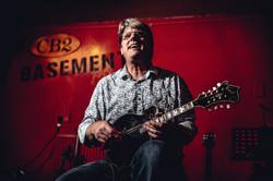 smiling mandolinist