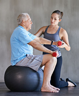 older man using weights with younger trainer